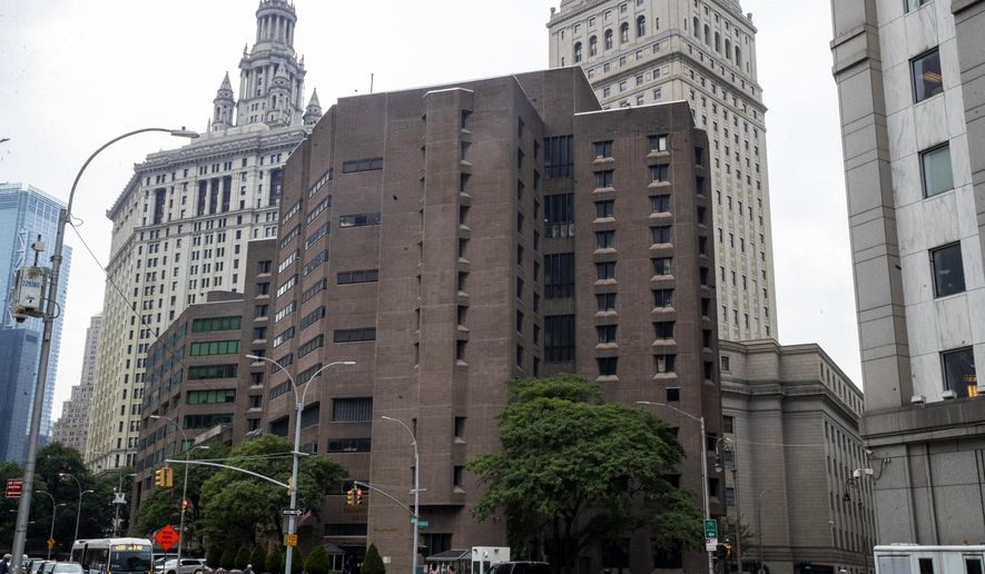FILE - This Aug. 13, 2019, file photo, shows the Metropolitan Correctional Center in New York. Two correctional officers responsible for guarding Jeffrey Epstein the night he killed himself at the Metropolitan Correctional Center have been charged with falsifying prison records. A grand jury indictment made public Tuesday, Nov. 19 accused guards Toval Noel and Michael Thomas of failing to perform checks on Epstein every half hour, as required, and of fabricating log entries to show they had. Epstein was found dead in his cell in August at the correctional center, where he had been awaiting trial on sex trafficking charges.  (AP Photo/Mary Altaffer, File)