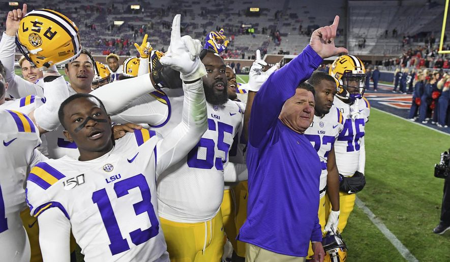 LSU coach Ed Orgeron and players celebrate after an NCAA college football game against Mississippi in Oxford, Miss., Saturday, Nov. 16, 2019. No. 1 LSU won 58-37. (AP Photo/Thomas Graning) **FILE**
