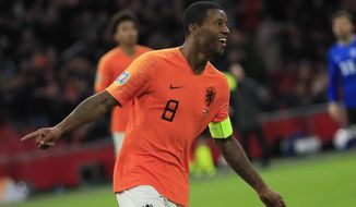 Netherlands' Georginio Wijnaldum celebrates scoring his side's fourth goal during the Euro 2020 group C qualifying soccer match between The Netherlands and Estonia at the Johan Cruyff ArenA in Amsterdam, Netherlands, Tuesday, Nov. 19, 2019. (AP Photo/Peter Dejong)
