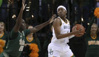 Baylor forward NaLyssa Smith, right, looks to the basket over South Florida forward Bethy Mununga, left, in the first half of an NCAA college basketball game, Tuesday, Nov. 19, 2019, in Waco, Texas. (AP Photo/Rod Aydelotte)