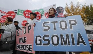 FILE - In this Nov. 15, 2019, file photo, protesters stage a rally to oppose a visit by U.S. Secretary for Defense Mark Esper in front of the Defense Ministry in Seoul, South Korea. Squeezed between a growing North Korean threat and a shaky alliance with the United States, South Korea must decide this week whether its national pride and deep frustrations with Japan are worth killing a major symbol of their security cooperation with Washington. (AP Photo/Ahn Young-joon, File)
