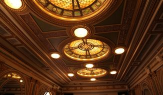 This Oct. 29, 2019 photo shows the triple-domed stained glass and bronze ceiling in the green marble lobby of the Hudson Theatre on West 44th Street in New York. A newly launched tour of the Hudson Theatre offers a rare chance to wander around the interior of Broadway's oldest theater and hear some of the fascinating stories that have happened in its 116 years. (AP Photo/Mark Kennedy)