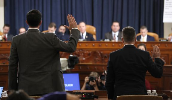 Ambassador Kurt Volker, right, former special envoy to Ukraine, and Tim Morrison, a former official at the National Security Council are sworn in to testify before the House Intelligence Committee on Capitol Hill in Washington, Tuesday, Nov. 19, 2019, during a public impeachment hearing of President Donald Trump's efforts to tie U.S. aid for Ukraine to investigations of his political opponents. (AP Photo/Jacquelyn Martin, Pool)