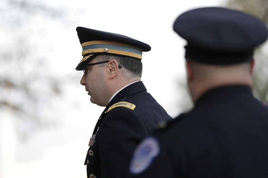 Lt. Col. Alexander Vindman arrives to testify before the House Intelligence Committee on Capitol Hill in Washington, Tuesday, Nov. 19, 2019, during a public impeachment hearing of President Donald Trump's efforts to tie U.S. aid for Ukraine to investigations of his political opponents. (AP Photo/Julio Cortez)