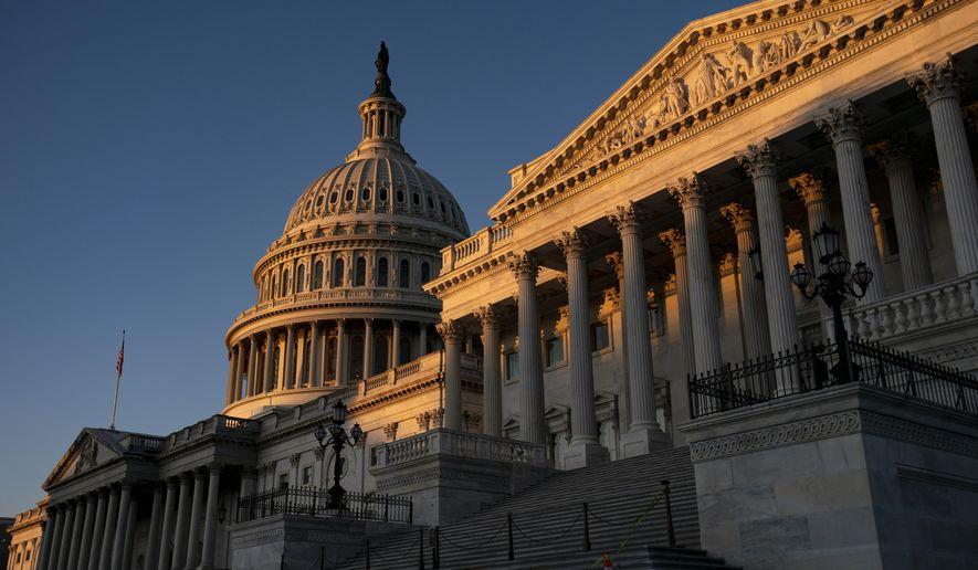 The Capitol is illuminated at sunrise in Washington, Wednesday, Nov. 6, 2019. (AP Photo/J. Scott Applewhite)