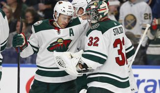 Minnesota Wild Zach Parise (11) and goalie Alex Stalock (32) celebrate a 4-1 victory over the Buffalo Sabres following the third period of an NHL hockey game Tuesday, Nov. 19, 2019, in Buffalo, N.Y. (AP Photo/Jeffrey T. Barnes)