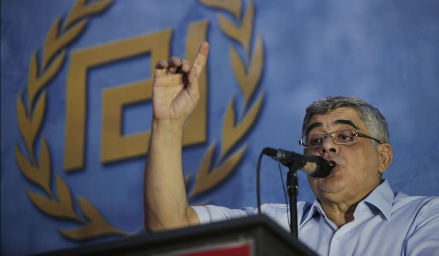 Nikos Michaloliakos, the leader of the extreme far-right Golden Dawn political party delivers his speech during a pre-election rally, in Athens, Wednesday, Sept. 16, 2015. Golden Dawn, founded as a neo-Nazi party three decades ago, is on course for third place in Greece's snap general election on Sept. 20, 2015. The stridently anti-austerity and anti-immigrant party could attract voters angry with the prospect of continued austerity under the third bailout, despite the partyís leadership and dozens of its members being on trial for a slew of offences. (AP Photo/Lefteris Pitarakis)