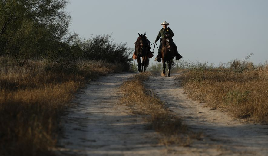 In this Wednesday, Nov. 6, 2019, photo, A mounted Border Patrol agent is seen near McAllen, Texas, along the U.S.-Mexico border. In the Rio Grande Valley, the southernmost point of Texas and historically the busiest section for border crossings, the U.S. Border Patrol is apprehending around 300 people daily, down from as many as 2,000 people a day in May. (AP Photo/Eric Gay)