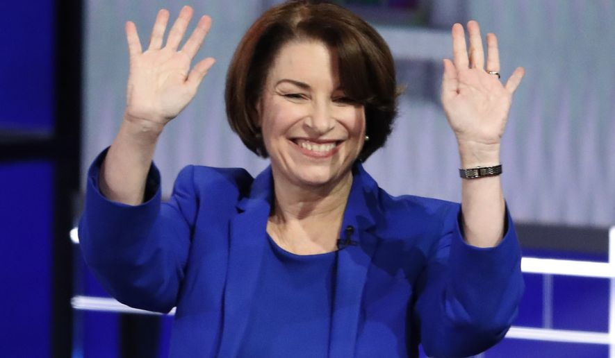Democratic presidential candidate Sen. Amy Klobuchar, D-Minn., waves before a Democratic presidential primary debate, Wednesday, Nov. 20, 2019, in Atlanta. (AP Photo/John Bazemore)