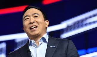 Andrew Yang walks onto the stage before a Democratic presidential primary debate, Wednesday, Nov. 20, 2019, in Atlanta. (AP Photo/John Bazemore)