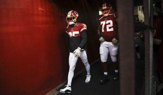 Washington Redskins strong safety Montae Nicholson (35) and offensive tackle Donald Penn (72) walk out together to take the field to begin the first half of an NFL football game against the New York Jets, Sunday, Nov. 17, 2019, in Landover, Md. (AP Photo/Patrick Semansky) ** FILE **