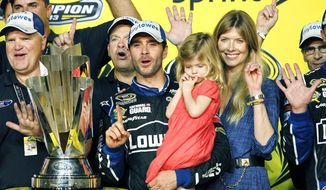 In this Nov. 17, 2013, file photo, Jimmie Johnson, center, his wife, Chandra, and his daughter, Genevieve, celebrate after he won his sixth NASCAR Sprint Cup Series championship, in Homestead, Fla. Jimmie Johnson is the latest NASCAR superstar to climb out of his car, with the seven-time champion announcing Wednesday, Nov. 20, 2019, that 2020 will be his final season of full-time racing. (AP Photo/Terry Renna, File) **FILE**