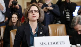 Deputy Assistant Secretary of Defense Laura Cooper arrives to testify before the House Intelligence Committee on Capitol Hill in Washington, Wednesday, Nov. 20, 2019, during a public impeachment hearing of President Donald Trump's efforts to tie U.S. aid for Ukraine to investigations of his political opponents. (AP Photo/Andrew Harnik)