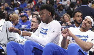 Memphis' James Wiseman, second from right, sits out the game along with Isaiah Stokes, right, in an NCAA college basketball game against Alcorn State Saturday, Nov. 16, 2019, in Memphis, Tenn. Malcolm Dandridge is first from right. (AP Photo/Karen Pulfer Focht) ** FILE **