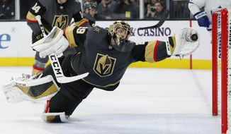 Vegas Golden Knights goaltender Marc-Andre Fleury (29) dives to make a glove save against the Toronto Maple Leafs during the third period of an NHL hockey game Tuesday, Nov. 19, 2019, in Las Vegas. (AP Photo/John Locher)