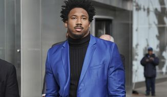 The Cleveland Browns Myles Garrett leaves an office building in New York, Wednesday, Nov. 20, 2019. The Browns star defensive end is asking the NFL to decrease his indefinite suspension. Garrett was banned last week for the rest of the regular season and playoffs for striking Pittsburgh quarterback Mason Rudolph with a helmet. Garrett is appealing the decision and his case is being heard Wednesday in New York by a league-appointed officer who will either lessen the penalty or put a definitive number of games on it. (AP Photo/Seth Wenig)