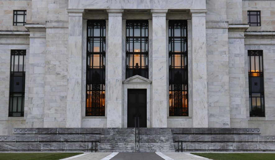 File-This July 31, 2019 file photo shows the Federal Reserve Building in Washington. The Federal Reserve says corporate debt remains at historically high levels but overall the U.S. financial system is resilient, a view in sharp contrast to the problems that led to the 2008 financial crisis. (AP Photo/Patrick Semansky, File)