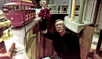 "Fred Rogers works with Lady Elaine Fairchilde, one of the puppets featured in the Land of Make-believe, on his children's television program, ""Mister Rogers' Neighborhood,"" in Pittsburgh on June 27, 1993. (AP Photo/Gene J. Puskar)"