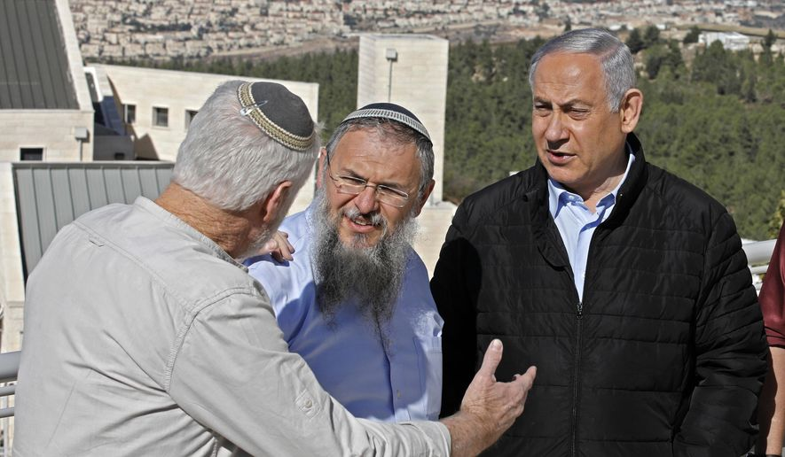 Israeli Prime Minister Benjamin Netanyahu, right, meets with heads of Israeli settlement authorities at the Alon Shvut settlement, in the Gush Etzion block, in the occupied the West Bank, Tuesday, November 19, 2019. (Menahem Kahana/ Pool via AP)