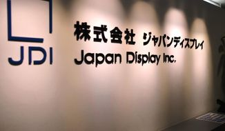 This July, 2017, photo, shows the logo of Japan Display Inc. in Tokyo. The Tokyo-based maker of displays said Thursday, Nov. 21, 2019, it is pursuing criminal charges against an employee it has accused of taking 578 million yen ($5.4 million) in fake deals. (Kyodo News via AP)