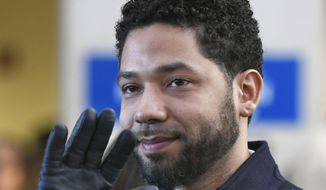 """FILE - In this March 26, 2019 file photo, former """"Empire"""" actor Jussie Smollett smiles and waves to supporters before leaving Cook County Court after his charges were dropped in Chicago. Smollett says his $10,000 payment after the close of a criminal case should prevent Chicago from seeking reimbursement for a police investigation of his claim that he was a victim of a racist and homophobic attack. Smollett's attorneys filed a response to Chicago's lawsuit Tuesday, Nov. 19, 2019. They also filed a counterclaim against the city, saying Smollett was the victim of a malicious prosecution. Smollett told police he was beaten by two men. Police said it was staged.(AP Photo/Paul Beaty, File)"""