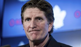 FILE - In this April 25, 2019, file photo, Toronto Maple Leafs coach Mike Babcock speaks to reporters in Toronto. The Maple Leafs fired Babcock on Wednesday, Nov. 20, 2019, and replaced him with Sheldon Keefe. (Christopher Katsarov/The Canadian Press via AP) ** FILE **