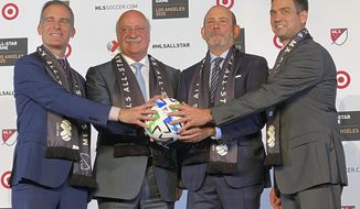 Los Angeles mayor Eric Garcetti, from left, LIGA MX Executive President Enrique Bonilla, Major League Soccer Commissioner Don Garber and LAFC President Tom Penn announce that the MLS 2020 All-Star soccer game will be held in Los Angeles, during a press conference at Banc of California Stadium in Los Angeles, Wednesday, Nov 20, 2019. The game, which will be held on July 29, 2020, will match the best of MLS against the all stars from Mexico's LIGA MX. (AP photo/Joe Reedy)