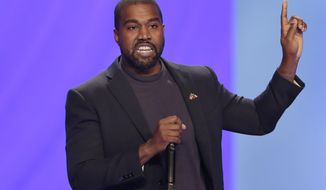 FILE - In this Nov. 17, 2019 file photo Kanye West answers questions from Sr. pastor Joel Osteen during the 11 am service at Lakewood Church, in Houston. West has been denied a permit to build an amphitheater on his ranch in Wyoming. The Park County Planning and Zoning Commission made the decision Tuesday, Nov.19, 2019, after the rapper changed his plans for the structure near Cody. West told county officials he now wants to include residential space. (AP Photo/Michael Wyke,File)