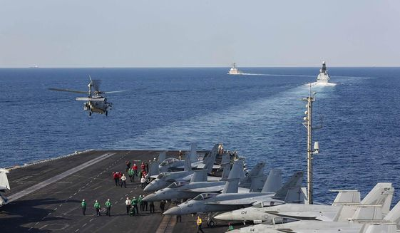 In this Tuesday, Nov. 19, 2019, photo made available by U.S. Navy, a helicopter lifts off of the aircraft carrier USS Abraham Lincoln as it transits the Strait of Hormuz. The U.S. aircraft carrier Abraham Lincoln sent to the Mideast in May over tensions with Iran transited the narrow Strait of Hormuz for the first time on Tuesday. The ship previously had been in the Arabian Sea outside of the Persian Gulf. (Mass Communication Specialist Seaman Stephanie Contreras/U.S. Navy via AP) **FILE**