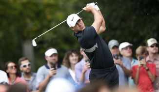 FILE - In this Aug. 25, 2019, file photo, Brooks Koepka hits from the second tee during the final round of the Tour Championship golf tournament at East Lake Golf Club in Atlanta. Koepka has withdrawn from the Presidents Cup because of a knee injury he suffered last month in South Korea. Koepka is the No. 1 player in the world and was the leading qualifier for the Presidents Cup, which will be played Dec. 12-15 at Royal Melbourne in Australia. Koepka will be replaced by Rickie Fowler. (AP Photo/John Bazemore) ** FILE **