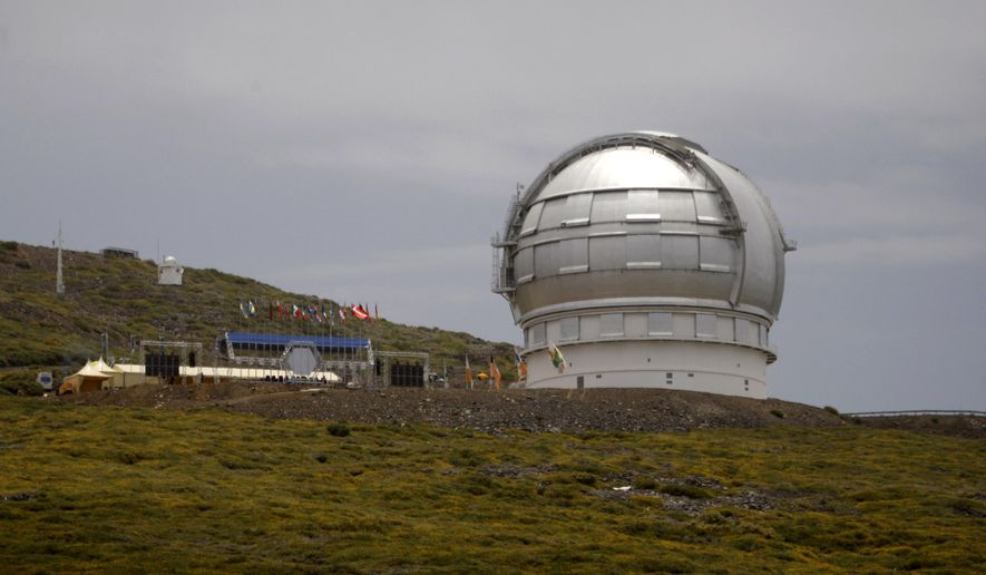 FILE - This July 24, 2009 file photo shows the Gran Telescopio Canarias, one of the the world's largest telescopes, at the Observatorio del Roque de los Muchachos on the Canary Island of La Palma, Spain. The director of a Spanish research center says a giant telescope, costing $1.4 billion, is one step nearer to being built on the Canary Islands in the event an international consortium gives up its plans to build it in Hawaii. (AP Photo/Carlos Moreno, File)
