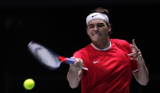 US Taylor Fritz returns the ball to Italy's Matteo Berrettini during their Davis Cup tennis match in Madrid, Spain, Wednesday, Nov. 20, 2019. (AP Photo/Manu Fernandez)
