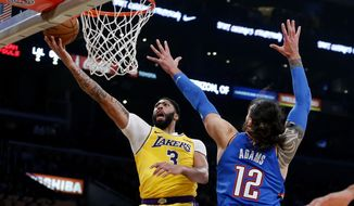 Los Angeles Lakers' Anthony Davis (3) goes to the basket as Oklahoma City Thunder's Steven Adams (12) dfends during the first half of an NBA basketball game Tuesday, Nov. 19, 2019, in Los Angeles. (AP Photo/Ringo H.W. Chiu)