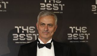 FILE - In this Sept. 23, 2019, file photo, Jose Mourinho arrives to attend the Best FIFA soccer awards, in Milan's La Scala theater, northern Italy. Tottenham has hired  Mourinho as manager, a day after firing Mauricio Pochettino. (AP Photo/Luca Bruno, File)
