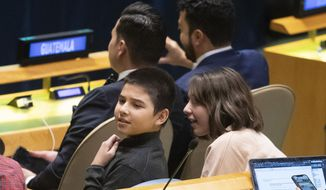Young members of the Guatemalan delegation find UNICEF Goodwill Ambassador David Beckham in the audience during a high-level meeting on the occasion of the 30th anniversary of the adoption of the Convention on the Rights of the Child, Wednesday, Nov. 20, 2019 at United Nations headquarters. (AP Photo/Mary Altaffer)