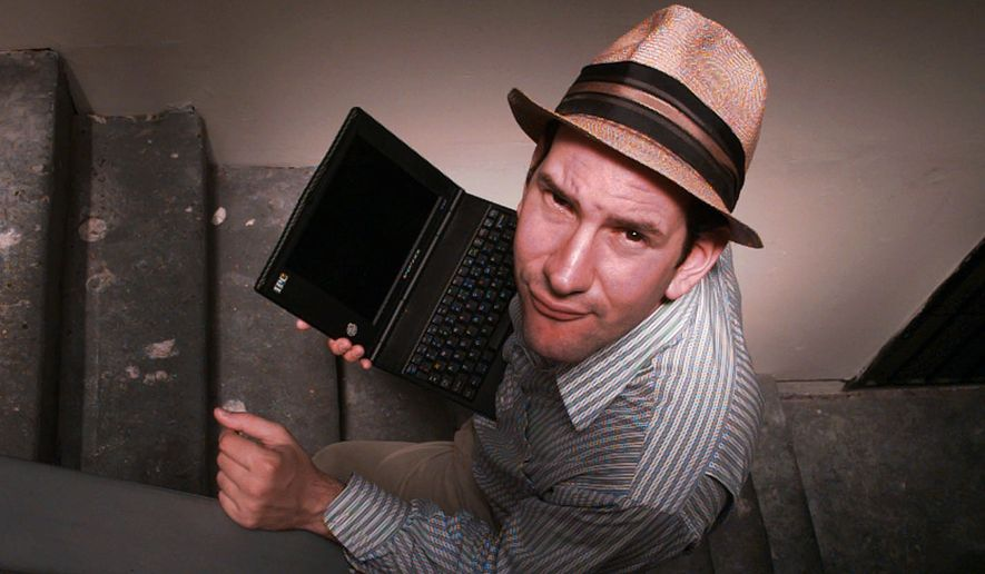 Matt Drudge carries a laptop computer as he walks up the stairs at his Hollywood-area apartment in Los Angeles on June 18, 1997. The Drudge Report, the daily barrage of breaking news, gossip and politics he e-mails to some 65,000 subscribers, is hotter than hot. (AP Photo/Michael Caulfield) ** FILE **