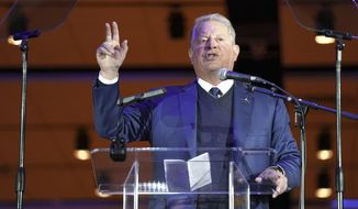 Former Vice President Al Gore speaks during a signing ceremony at Liberty Science Center in Jersey City, N.J., Tuesday, Nov. 19, 2019. Democratic Gov. Phil Murphy signed an executive order Tuesday alongside Gore that commits the state to produce 7,500 megawatts of electricity through wind energy by 2035. That's more than double the goal Murphy previously set of 3,500 megawatts by 2030. (AP Photo/Seth Wenig)