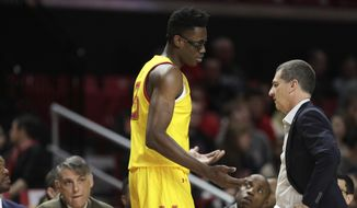 Maryland forward Jalen Smith, left, talks with head coach Mark Turgeon during the first half of an NCAA college basketball game against Oakland, Saturday, Nov. 16, 2019, in College Park, Md. (AP Photo/Julio Cortez) ** FILE **