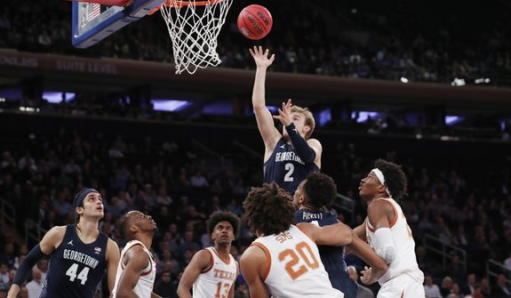 Georgetown guard Mac McClung (2) goes up for two points leaving four Texas defendeers in his wake during the second half of the first round of the 2K Empire Classic NCAA college basketball tournament, Thursday, Nov. 21, 2019, in New York. Georgetown defeated Texas 82-66. (AP Photo/Kathy Willens)