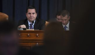 Ranking member Rep. Devin Nunes of Calif., left,  waits for former White House national security aide Fiona Hill, right, and David Holmes, a U.S. diplomat in Ukraine, to testify before the House Intelligence Committee on Capitol Hill in Washington, Thursday, Nov. 21, 2019, during a public impeachment hearing of President Donald Trump's efforts to tie U.S. aid for Ukraine to investigations of his political opponents. (Matt McClain/Pool Photo via AP)