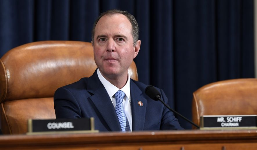 House Intelligence Committee Chairman Adam Schiff, D-Calif., watches as former White House national security aide Fiona Hill, and David Holmes, a U.S. diplomat in Ukraine, testify before the House Intelligence Committee on Capitol Hill in Washington, Thursday, Nov. 21, 2019, during a public impeachment hearing of President Donald Trump's efforts to tie U.S. aid for Ukraine to investigations of his political opponents.(AP Photo/Susan Walsh)