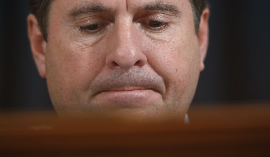 Ranking member Rep. Devin Nunes of Calif., questions former White House national security aide Fiona Hill, and David Holmes, a U.S. diplomat in Ukraine, as they testify before the House Intelligence Committee on Capitol Hill in Washington, Thursday, Nov. 21, 2019, during a public impeachment hearing of President Donald Trump's efforts to tie U.S. aid for Ukraine to investigations of his political opponents. (AP Photo/Andrew Harnik)
