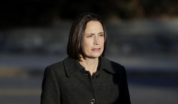 Former White House national security aide Fiona Hill arrives to testify before the House Intelligence Committee on Capitol Hill in Washington, Thursday, Nov. 21, 2019, during a public impeachment hearing of President Donald Trump's efforts to tie U.S. aid for Ukraine to investigations of his political opponents. (AP Photo/Julio Cortez)