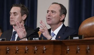 House Intelligence Committee Chairman Adam Schiff, D-Calif., with committee staffer Daniel Noble at left, makes impassioned remarks at the conclusion of a week of public impeachment hearings on President Donald Trump's efforts to tie U.S. aid for Ukraine to investigations of his political opponents, on Capitol Hill in Washington, Thursday, Nov. 21, 2019. Former White House national security aide Fiona Hill, and David Holmes, a U.S. diplomat in Ukraine, were the final witnesses today. (AP Photo/J. Scott Applewhite)