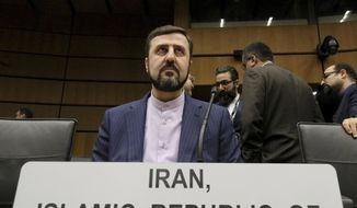 Iran's Ambassador to the International Atomic Energy Agency, IAEA, Gharib Abadi, waits for the start of the IAEA board of governors meeting at the International Center in Vienna, Austria, Thursday, Nov. 21, 2019. (AP Photo/Ronald Zak)
