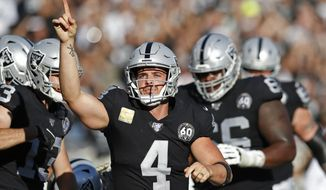 Oakland Raiders quarterback Derek Carr celebrates after scoring a touchdown during the first half of an NFL football game against the Cincinnati Bengals in Oakland, Calif., Sunday, Nov. 17, 2019. (AP Photo/D. Ross Cameron)