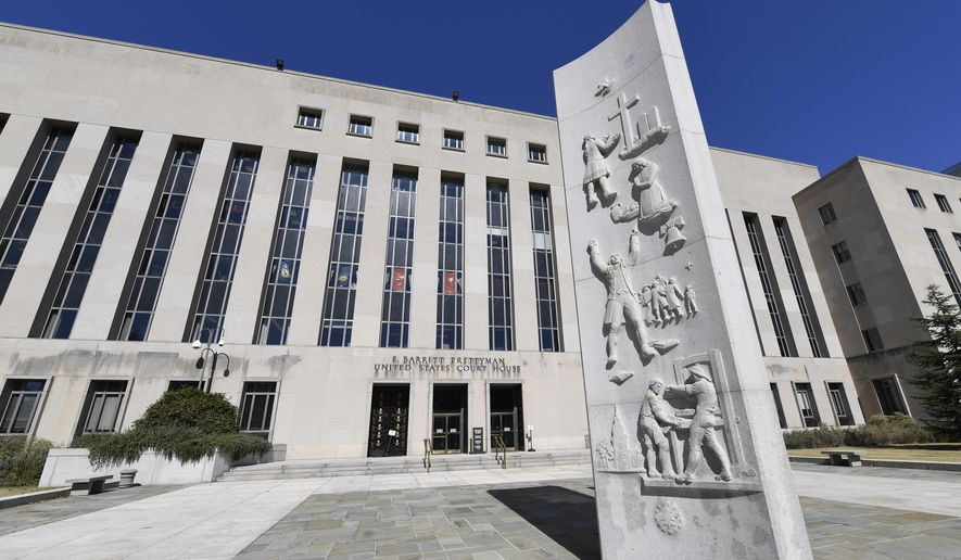 In this Oct. 11, 2019 file photo, a view of the E. Barrett Prettyman United States Courthouse in Washington. (AP Photo/Susan Walsh) **FILE**