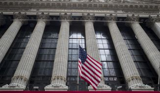 In this Nov. 20, 2018, file photo, a U.S. flag flies outside New York Stock Exchange. (AP Photo/Mary Altaffer, File )