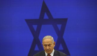 FILE - In this Sept. 10, 2019 file photo, Israeli Prime Minister Benjamin Netanyahu, speaks during a press conference in Tel Aviv, Israel. Israel's attorney general plans to announce Thursday whether he will indict Prime Minister Benjamin Netanyahu on an array of corruption charges, which would throw Israel's political scene into disarray and potentially hasten the end of his decade-long rule. (AP Photo/Oded Balilty, File)