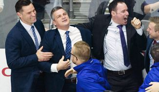 In this June 14, 2018, photo, Toronto Marlies head coach Sheldon Keefe, second from left, celebrates with his coaching and training staff after defeating the Texas Stars to win the AHL Calder Cup championship in Toronto. Keefe was officially introduced Thursday morning, Nov. 21, 2019,  as the 31st head coach of the NHL hockey Toronto Maple Leafs. (Nathan Denette/The Canadian Press via AP)